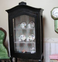 Cabinet Curio Glass Cabinet filled with dish set